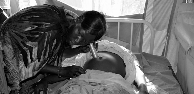 A midwife examines a pregnant woman in Bentiu. (photo: UNFPA | Amadou Baraze				)